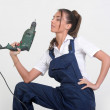 Closeup of a beauty girl with drill machine on white background — Stock Photo