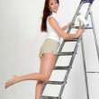 The girl is the house painter — Stock Photo #9306023