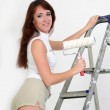 The girl is the house painter — Stock Photo #9306038