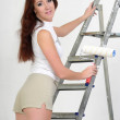 The girl is the house painter — Stock Photo #9306041