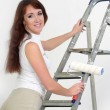 The girl is the house painter — Stock Photo #9306060
