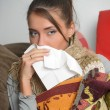 Young woman is ill in bed She is feeling miserable — Stock Photo
