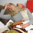 Young woman is ill in bed  She is feeling miserable - Stock Photo
