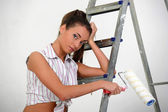 The girl is the house painter — Stock Photo