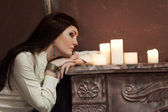 Girl at night with candles — Stock Photo
