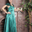Young beautiful woman in an emerald dress — Stock Photo #9512497
