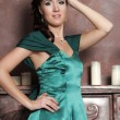 Young beautiful woman in an emerald dress — Stock Photo #9512585