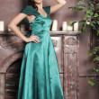 Young beautiful woman in an emerald dress — Stock Photo #9512595