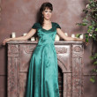 Young beautiful woman in an emerald dress — Stock Photo #9512691