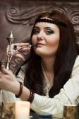 Girl smoking hookah — Stockfoto