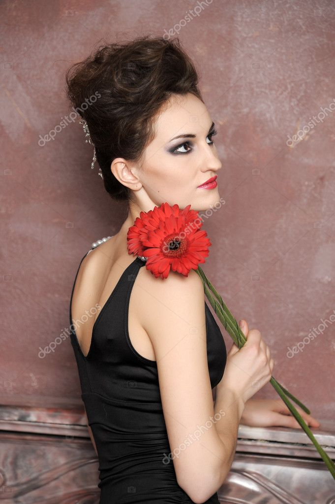 Attractive woman with red flowers — Stock Photo #9780124