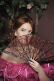 Woman with fan in medieval dress — Stock Photo