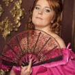 Woman with fan in medieval dress - Lizenzfreies Foto