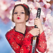 Royalty-Free Stock Photo: A girl handling a long samurai sword