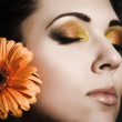Stock Photo: Beautiful woman with a bright make-up