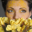 Woman with yellow flowers — Stock Photo