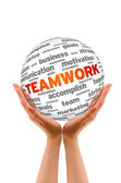 Hands holding a Teamwork Sphere — Stock Photo