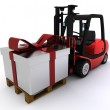Forklift truck with christmas gift box — Stock Photo