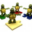 Tortoises on jigsaw pieces - Stock Photo
