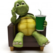 Stock Photo: Tortoise relexing in armchair drinking soda