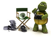 Tortoise with a directors chair — Stockfoto