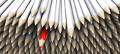 White pencil crayons with stand out red pencil — Stock Photo