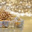 Christmas gifts and golden decorations — Stock Photo