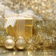 Golden Christmas gift — Stock Photo