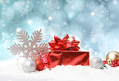Christmas decorations on blue glittery background — Stock Photo