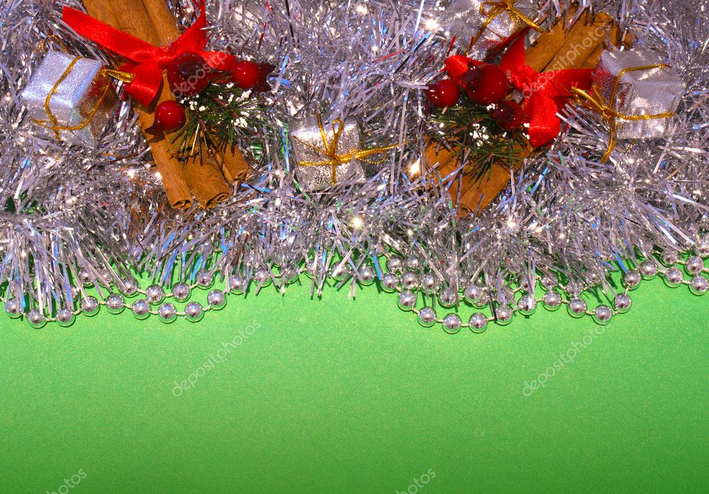 Christmas decorations on a green background — Stok fotoğraf #9319996