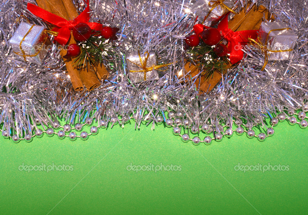 Christmas decorations on a green background — Zdjęcie stockowe #9319996