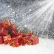 Christmas gifts in snow — Stok fotoğraf