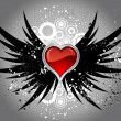 Glossy heart on grunge wings — Stock Photo