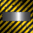Metal plate on grunge background — Stock Photo