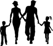 Family silhouette walking — Stock Photo