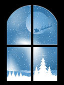 Snowy night through a window — Stock Photo