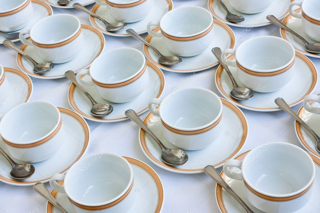 Many rows of coffee cup and saucer with teaspoon — Stock Photo #10429328