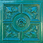 Bas-relief on the green wall — Stock Photo
