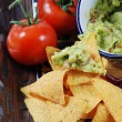 Guacamole and nachos - Stock Photo