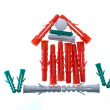 Small house from plastic plugs for fastening. — Stock Photo