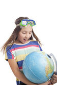 School age girl with globe — Stockfoto