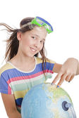 School age girl with globe — Stock Photo