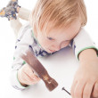 Boy with hammer and nail — Stock Photo #10225205