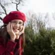 Positive school age girl is in the park — Stock Photo