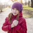 Girl holds her hands together and looking to the camera — Stock Photo #10391605