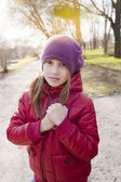 Girl holds her hands together and looking to the camera — Stock Photo