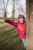 Smiling school age girl is in the park — Stock Photo