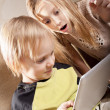 Girl and boy with tablet computer — Stock Photo