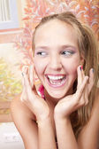 Smiling beautiful girl with colored nails — Stock Photo