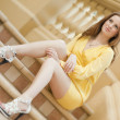 Young woman sitting on the stair — Stock Photo #10052539